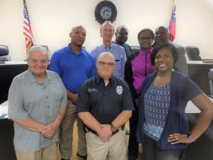Mayor Stankiewicz, Councilman Reggie Jackson, Police Chief Brian Harr, Councilman Fred Higgins, Councilman Marichal Price, M