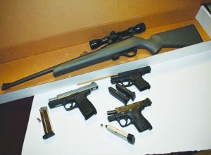 The stolen firearms recovered from the Dodge Charger.